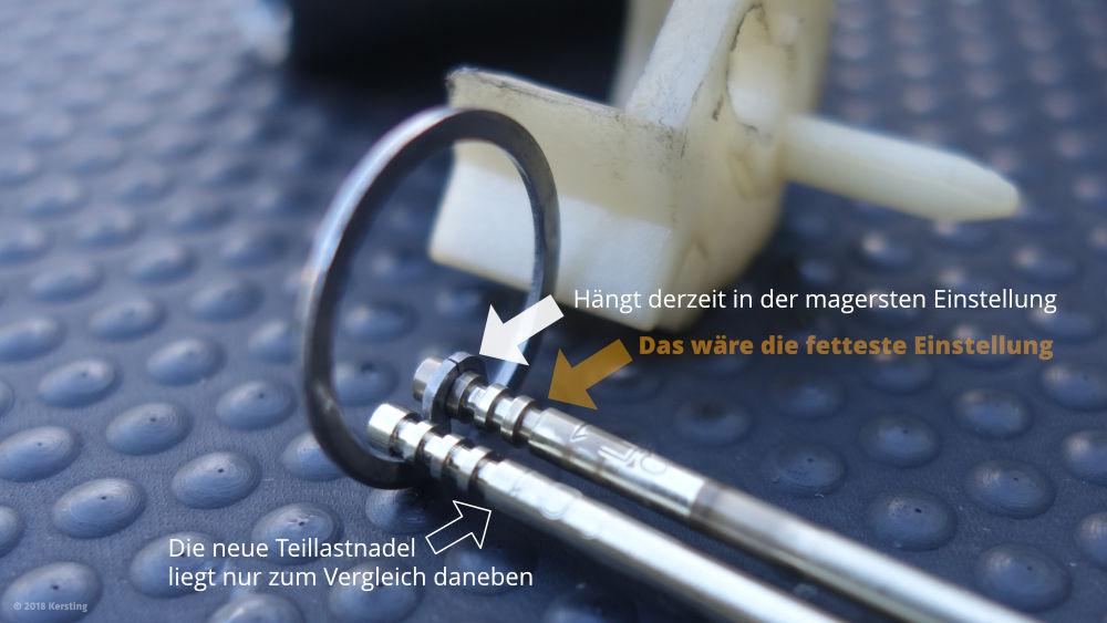 Die vier Ringnuten in der Düsennadel dienen der Einstellung der Höhe